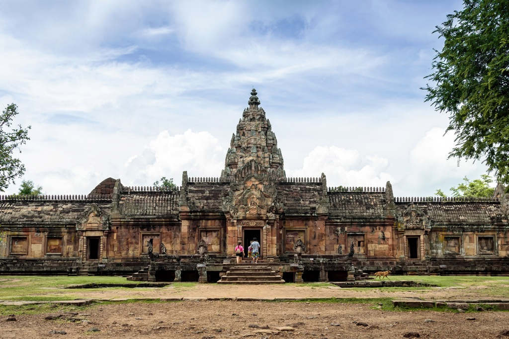 Travelers walking into the entrance of Phanom Rung Castle in Buriram Thailand.