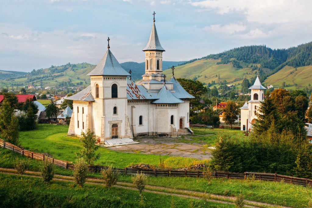 Romanian mountain landscape and church.