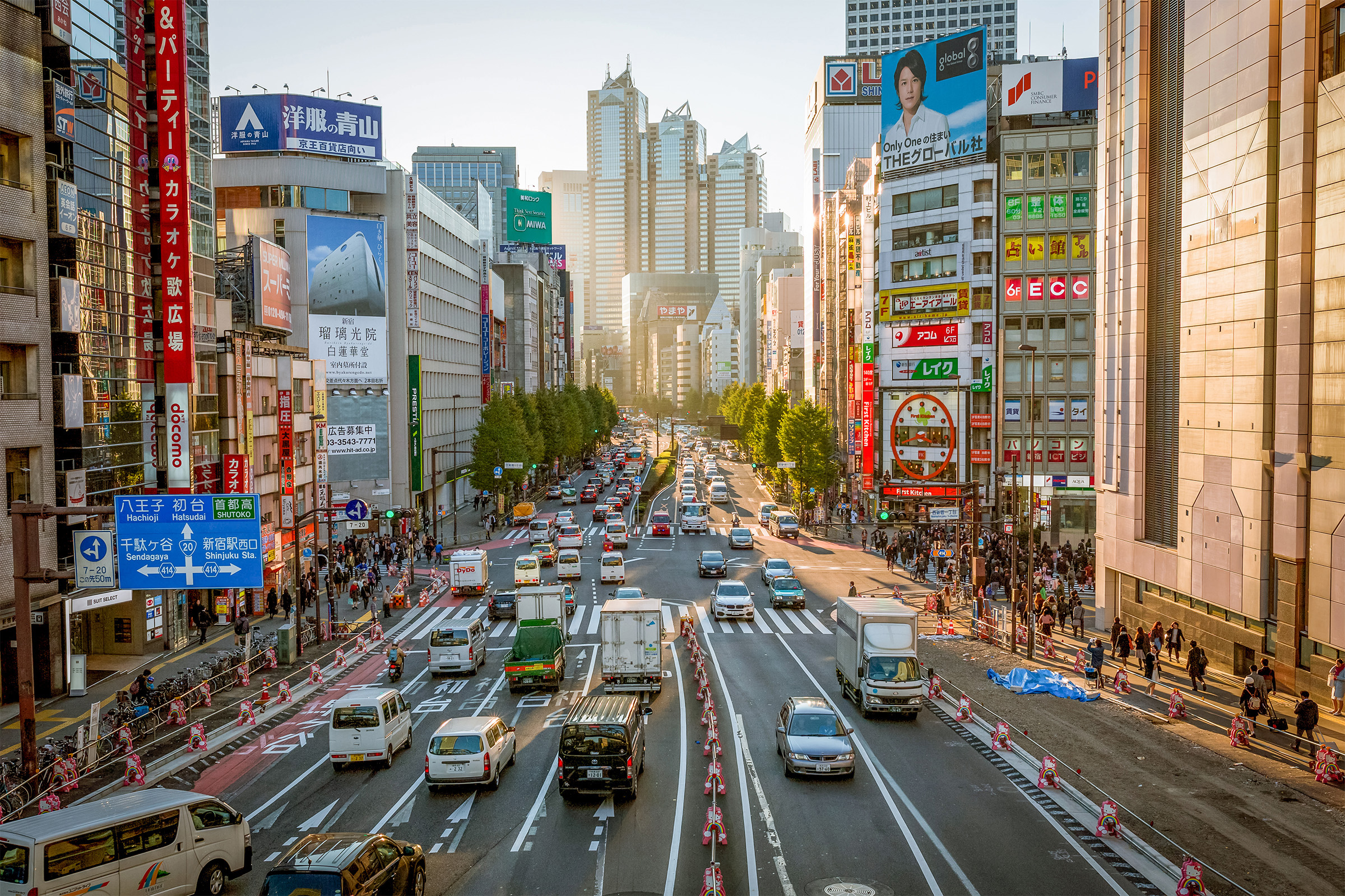 A busy city street surrounded by skyscrapers in Tokyo, Japan.