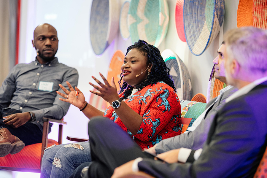 Speakers on a panel discuss tourism on stage at the Africa Travel Summit.