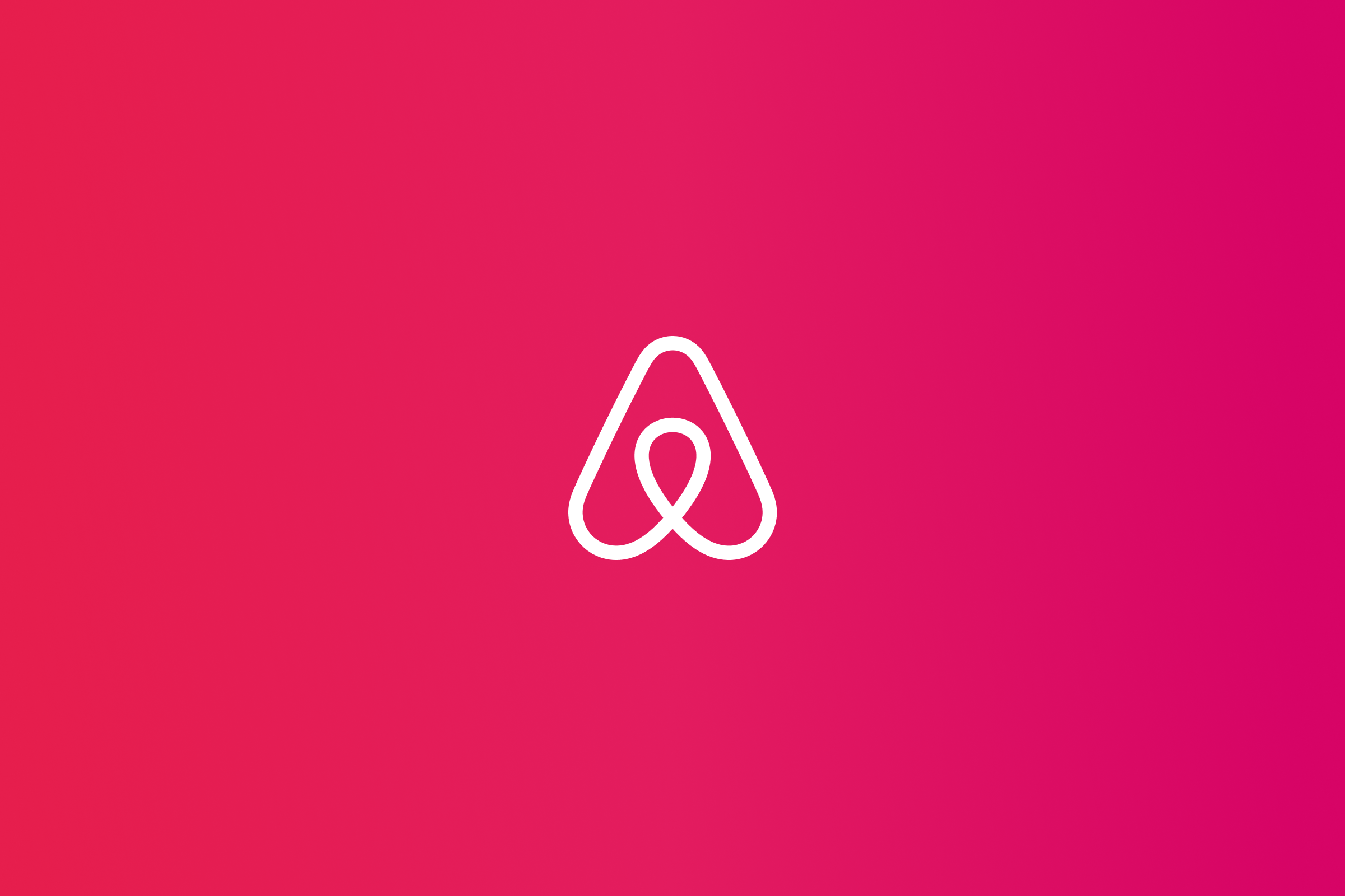 Airbnb logo placed on deep pink gradient colored background
