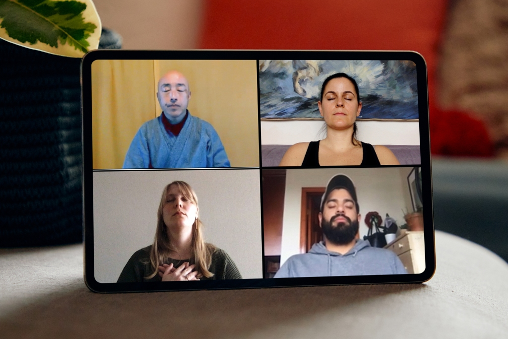 Guests in a meditation Airbnb Online Experience are seen closing their eyes on an iPad.
