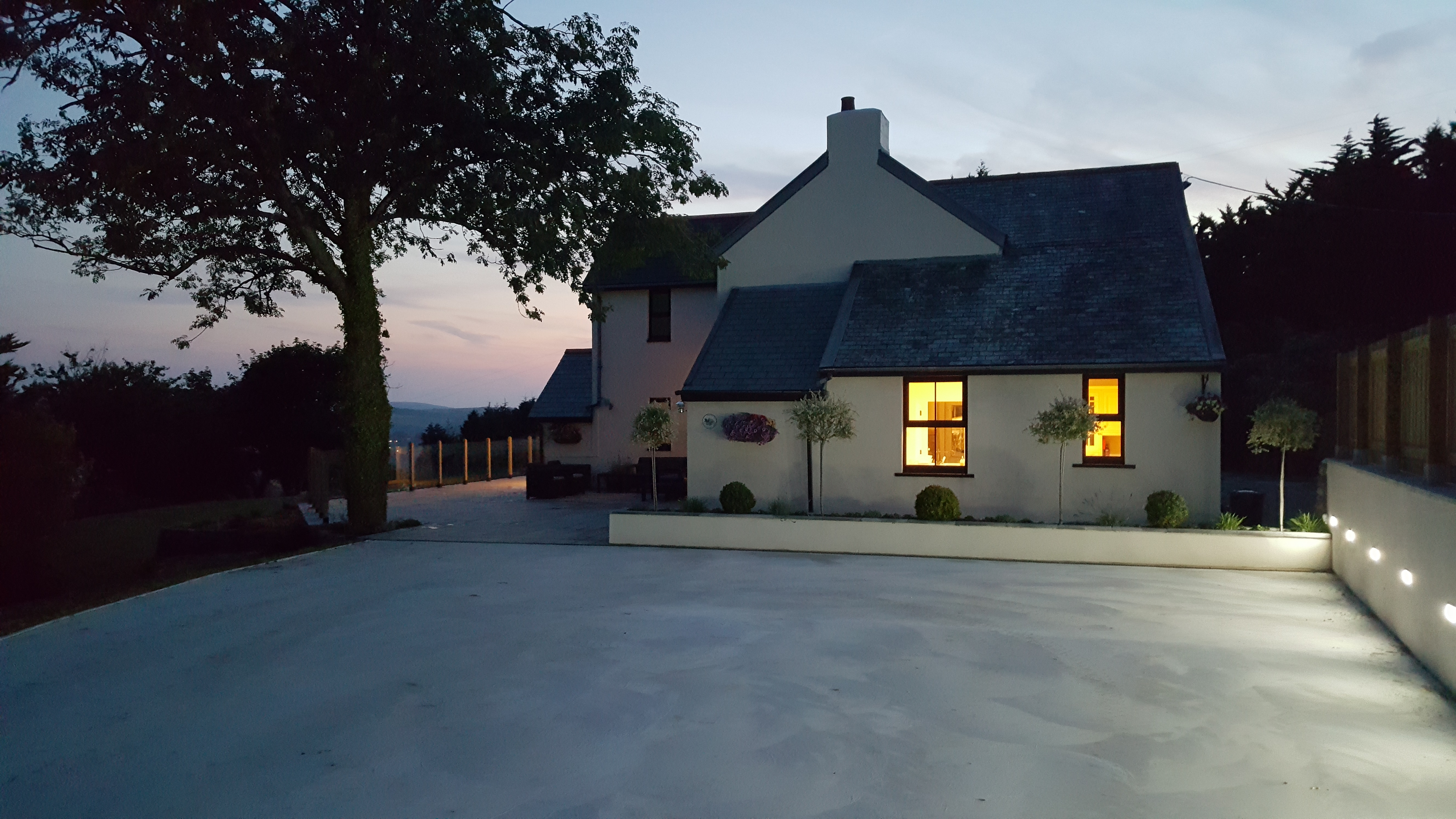 Smooth step-free drive and terrace at Superhost Sam's farm in Devonshire countryside in the UK