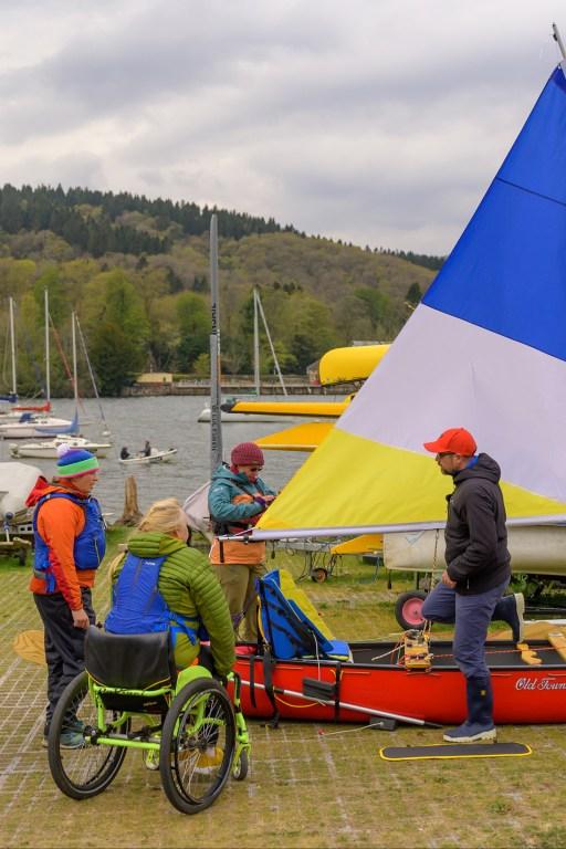 Several guests preparing to go canoe sailing on the lake in Newby Bridge, United Kingdom