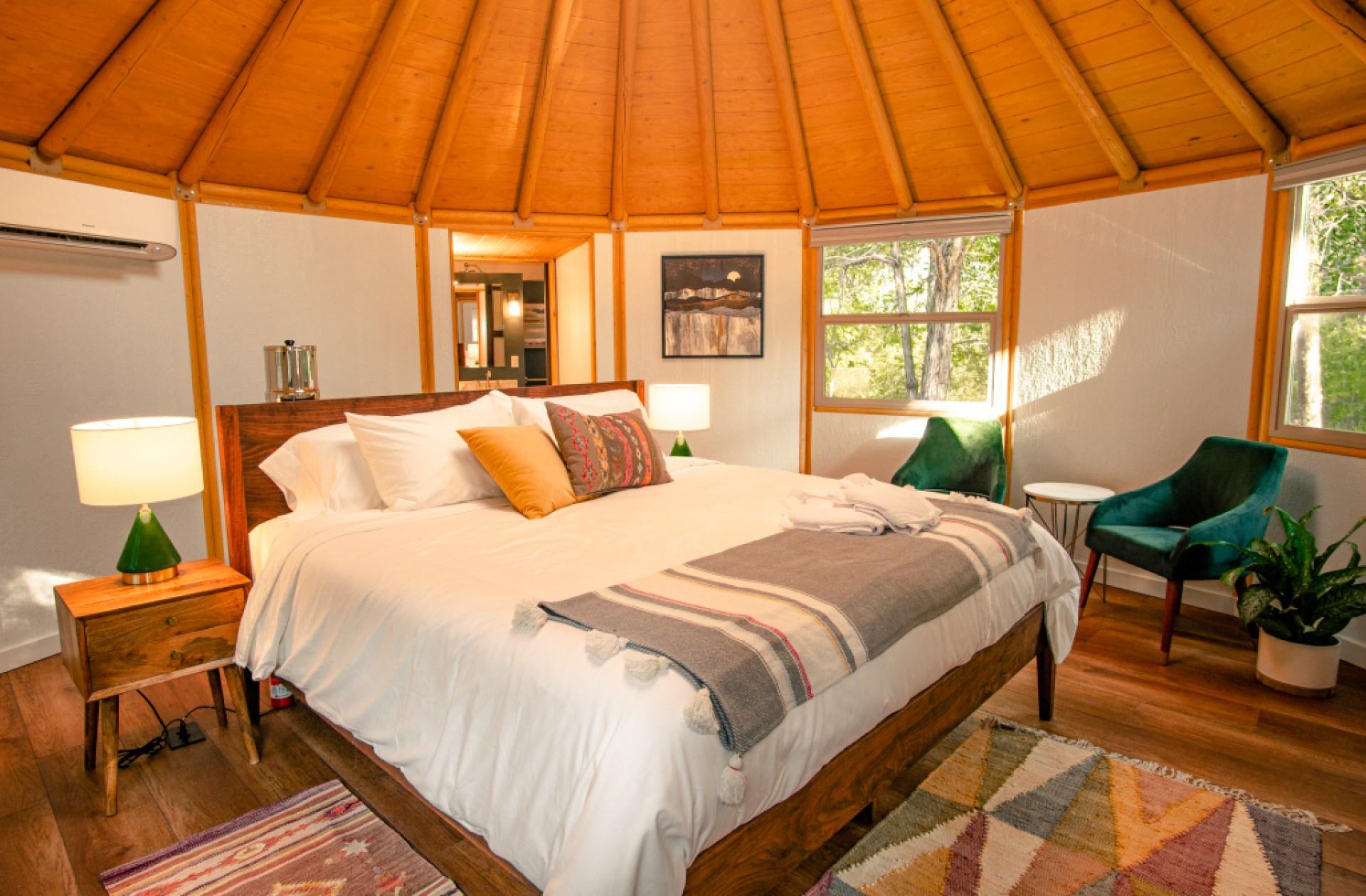 Bohemian bedroom of luxury yurt cabin in Bastrop, TX