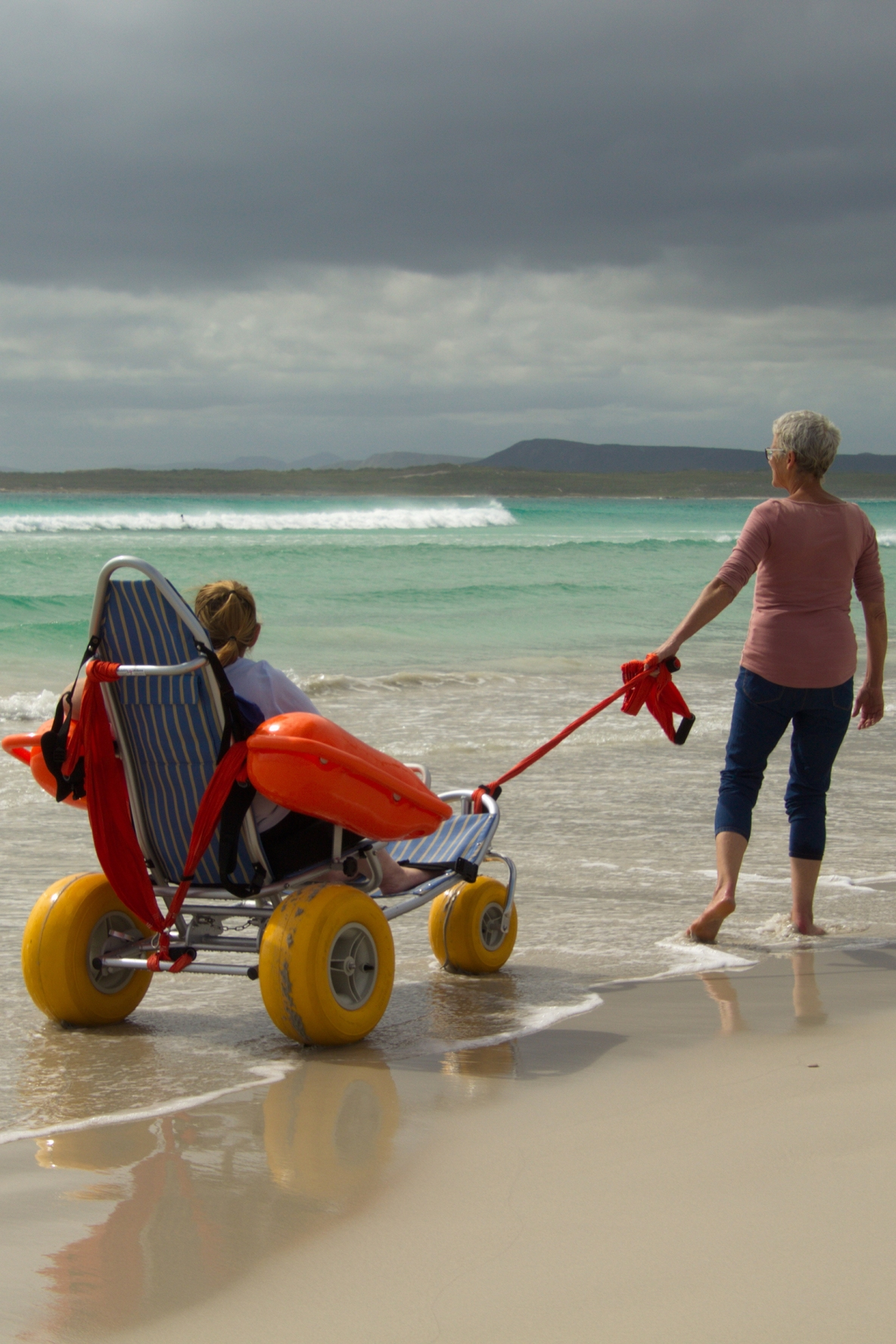 A guest taking a beach excursion in a specialized beach wheelchair.